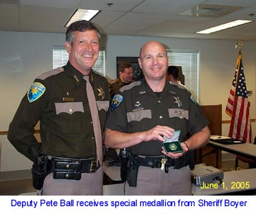 Deputy Ball receives highly coveted Sheriff's Medallion.