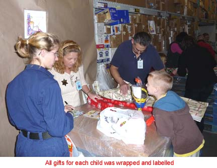 Volunteers wrap the gifts